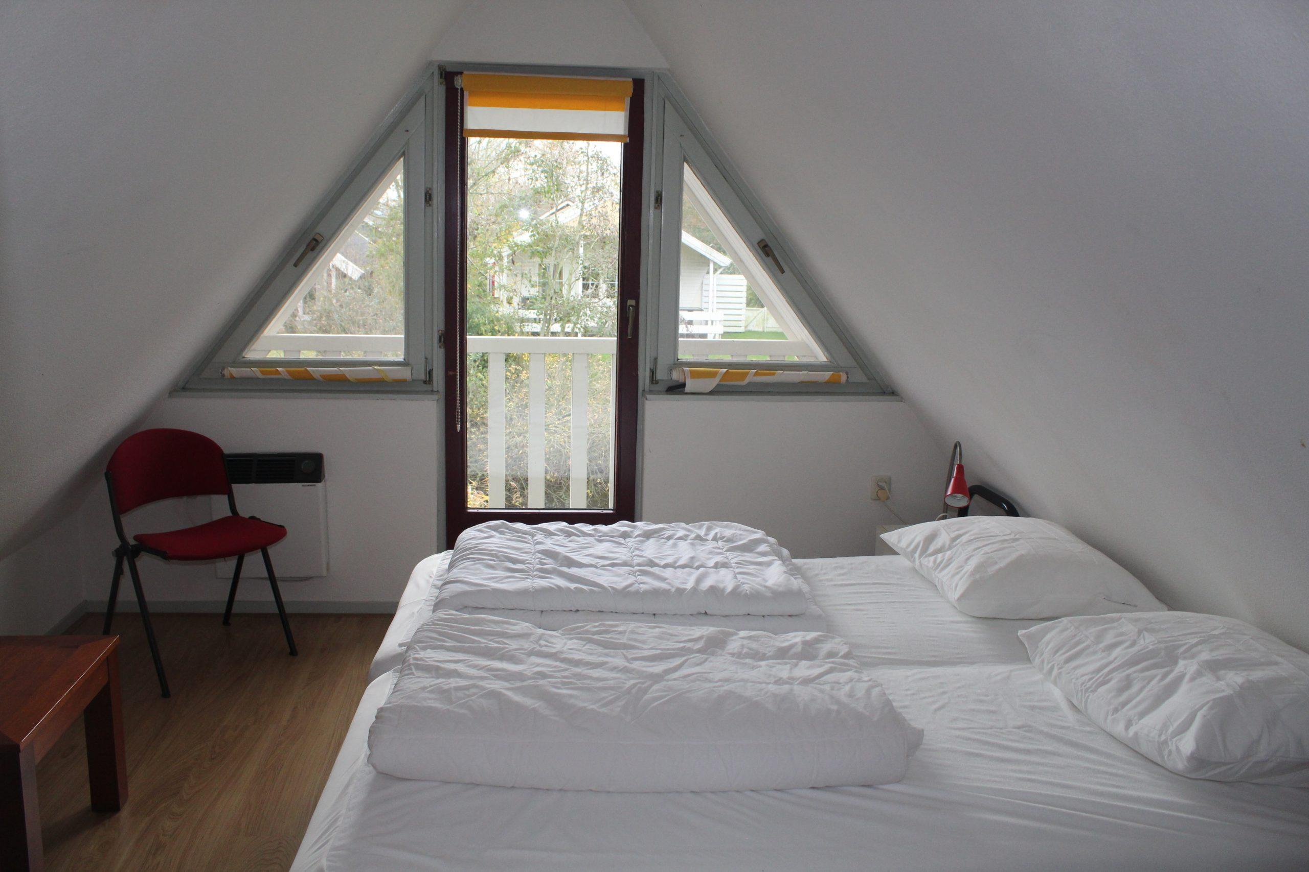Slaapkamer boven tweepersoonsbed Lauwersmeer